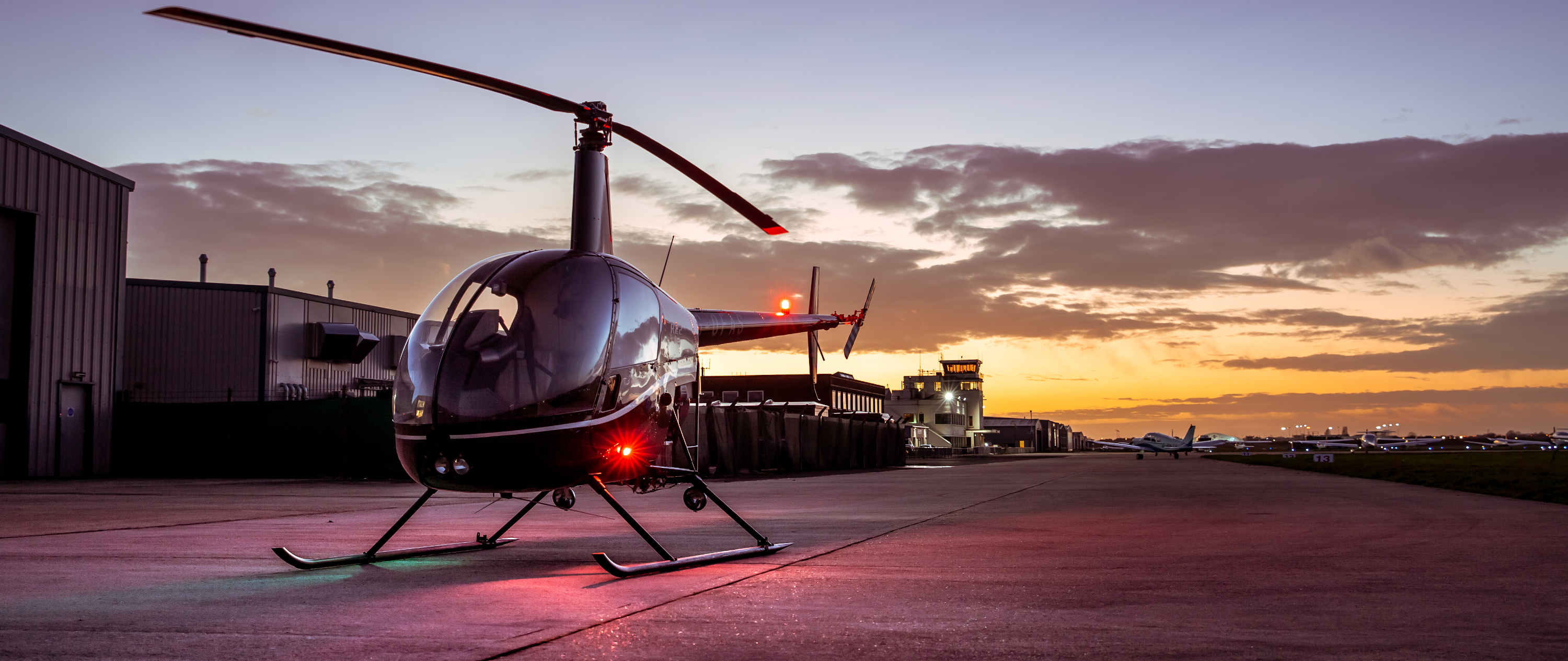 Robinson R22 helicopter in sunset