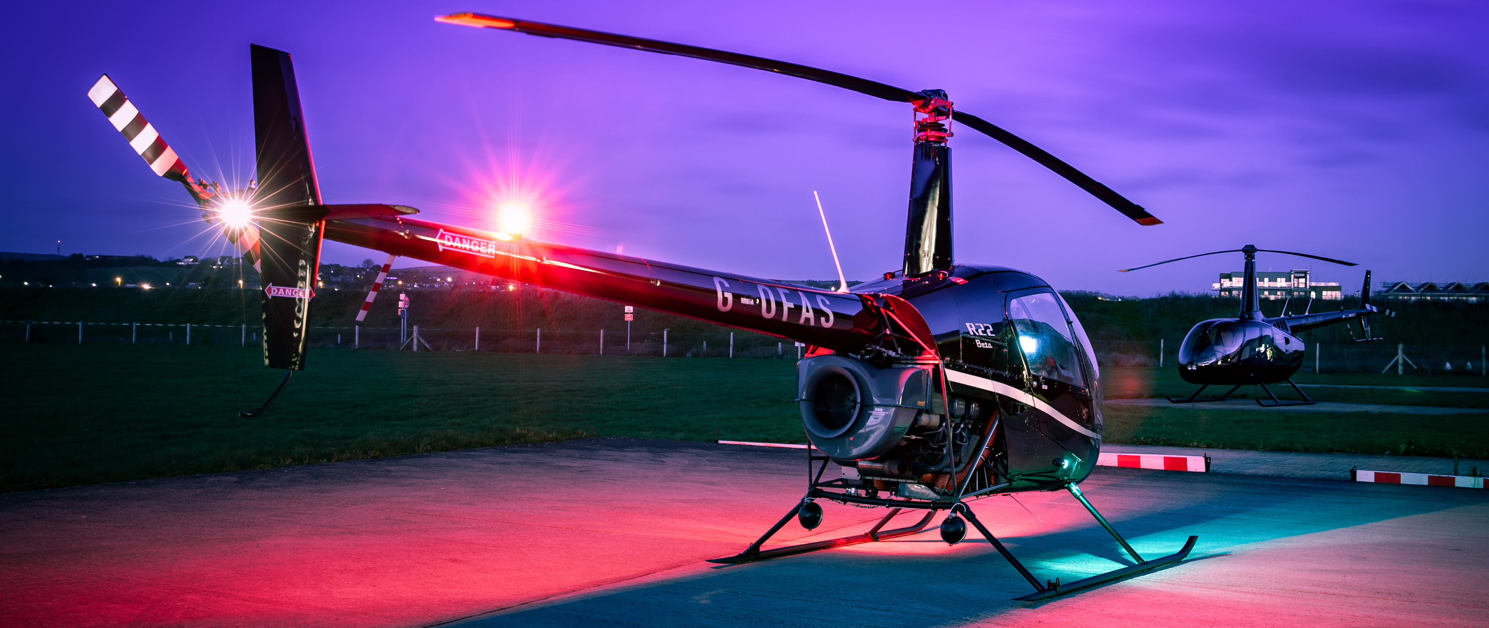 Robinson R22 helicopter with R66 in background