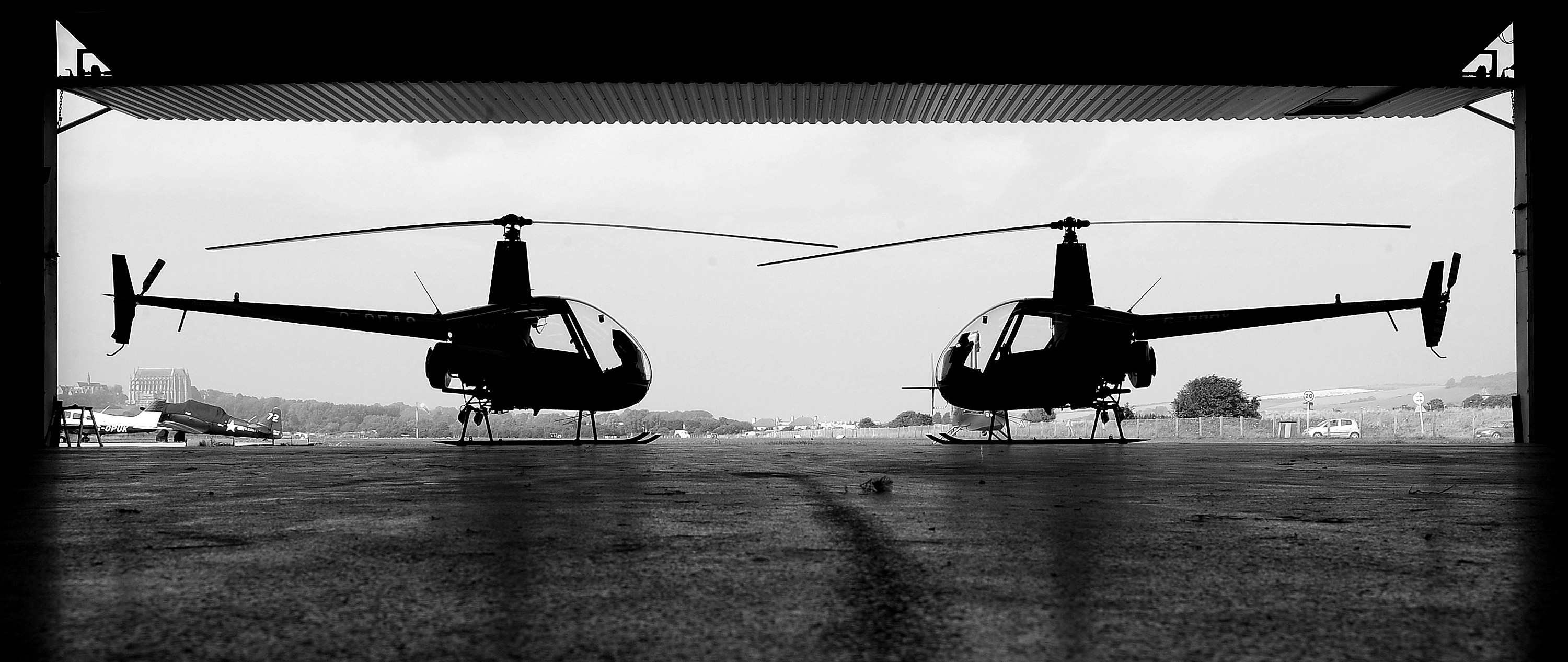 Two Robinson R22s from the Advance Helicopters hangar